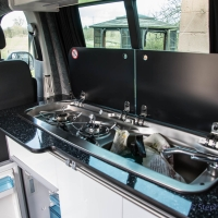 VW T5 storage cupboards, fridge and hob.