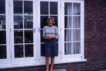 Joan Blasdale outside their house in Macclesfield