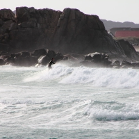 Portinfer Bay and surfers, Guernsey, 2010
