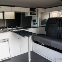 VW T5 storage cupboards, fridge and hob, table