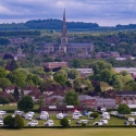 View of Salisbury Cathedral and campsite from Old Sarum. Van the Van behind tree on left.