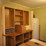 The dresser area and fridge.