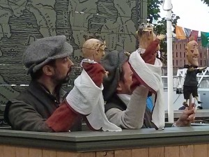 The Julius Caesar puppet show outside The Globe Theatre